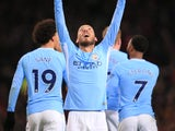 David Silva celebrates his opener during the Premier League game between Manchester United and Manchester City on December 10, 2017