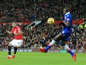 Anthony Martial fires past Kurt Zouma for the second during the Premier League game between Manchester United and Stoke City on January 15, 2018