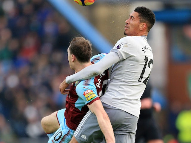 Ashley Barnes grapples with Chris Smalling during the Premier League game between Burnley and Manchester United on January 20, 2018