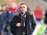 Carlos Carvalhal arrives for the Premier League game between Swansea City and Liverpool on January 22, 2018