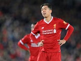 Liverpool striker Roberto Firmino reacts during his side's FA Cup fourth round clash with West Bromwich Albion at Anfield on January 27, 2018