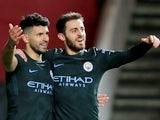 Sergio Aguero celebrates with Bernardo Silva after scoring during the EFL Cup game between Bristol City and Manchester City on January 23, 2018