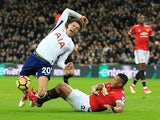 Antonio Valencia takes down Dele Alli during the Premier League game between Tottenham Hotspur and Manchester United on January 31, 2018
