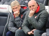 Arsene Wenger and Steve Bould watch on during the Premier League game between Brighton & Hove Albion and Arsenal on March 4, 2018