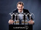 Roger Federer poses with his collection of Laureus Awards in February 2018