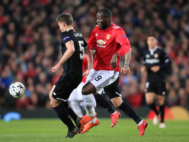 Clement Lenglet and Romelu Lukaku in action during the Champions League round-of-16 game between Manchester United and Sevilla on March 13, 2018