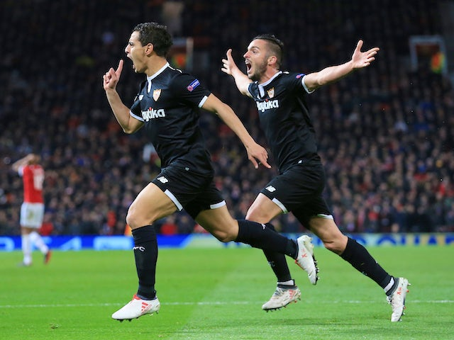 Wissam Ben Yedder celebrates scoring with Pablo Sarabia during the Champions League round-of-16 game between Manchester United and Sevilla on March 13, 2018