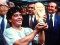 Argentina's Diego Maradona lifts the World Cup trophy after helping his team to the 1986 title