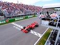 Ferrari's Sebastian Vettel passes the chequered flag to win the Canadian Grand Prix on June 10, 2018