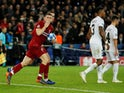 Liverpool's James Milner celebrates scoring from the penalty spot against Paris Saint-Germain on November 28, 2018
