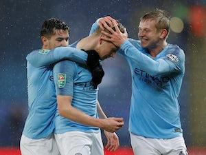 Man City survive penalties to make semi-finals