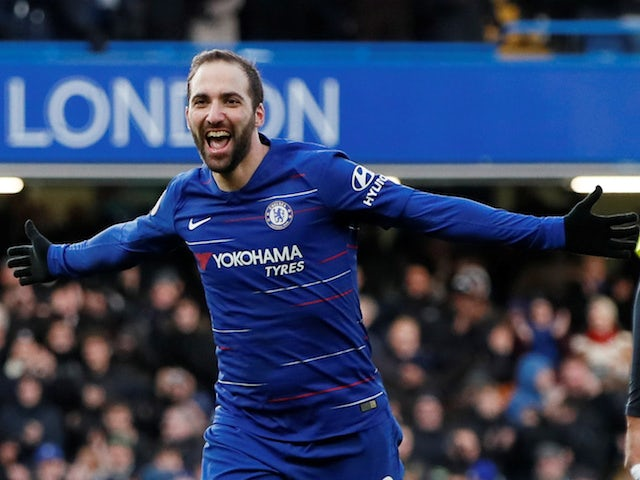 Chelsea's Gonzalo Higuain celebrates after scoring his second against Huddersfield on February 2, 2019