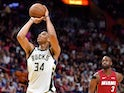 Milwaukee Bucks forward Giannis Antetokounmpo (34) at the free throw line as Miami Heat guard Dwyane Wade (3) looks on during the second half at American Airlines Arena on March 16, 2019