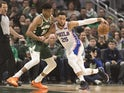 Philadelphia 76ers guard Ben Simmons (25) moves to the basket against Milwaukee Bucks forward Giannis Antetokounmpo (34) during the first quarter at Fiserv Forum on March 17, 2019