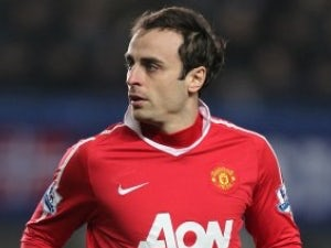 Berbatov picks up ankle injury