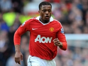 Evra admits private Nasri talks