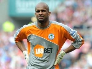 Ali Al-Habsi signs to Wigan Athletic