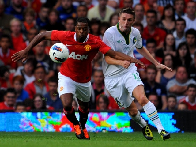 Patrice Evra and Robbie Keane