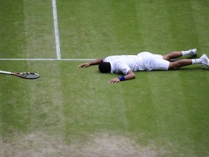 Tsonga knocks Federer out of Wimbledon