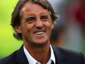 Mancini closes on Bolton defender Cahill