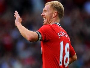 Paul Scholes rejoins Man United
