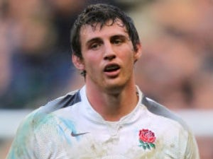 Wood defends new England kit