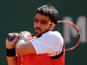 Result: Janowicz gifted semi-final spot