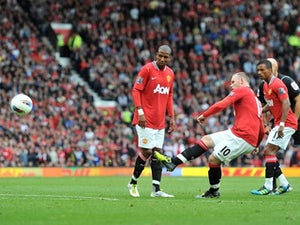 Rooney plays down RVP battle