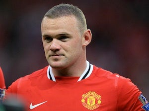 Wayne Rooney attends Grand Final