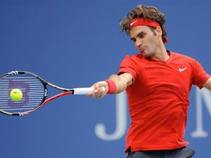 Federer apologises for walkover