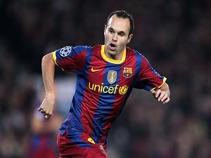 Iniesta out for two weeks