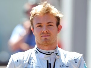 Rosberg grabs maiden pole in China