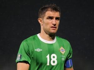 Hughes to quit N. Ireland duty