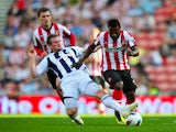 Stephane Sessegnon and Chris Brunt