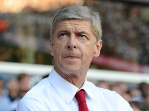 Wenger happy with improving full-backs