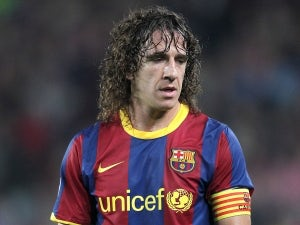 Puyol signs new Barcelona deal