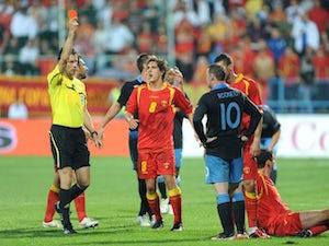 Ferdinand tips Rooney to
