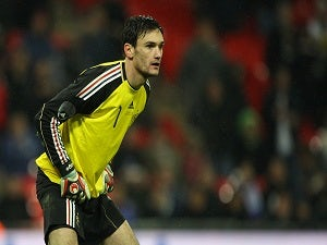 Lloris vows to work hard at Spurs
