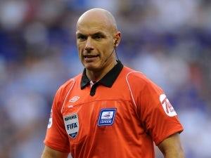 Referee Webb halts troubled Euro qualifier