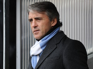 Mancini, Gerrard clash over Johnson tackle