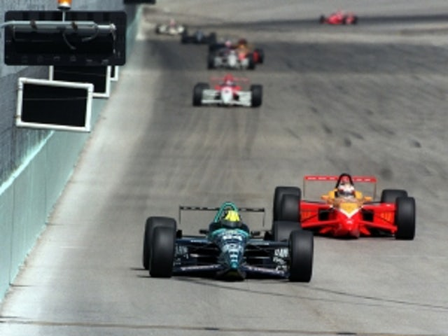 British driver Dan Wheldon airlifted to hospital after 15-car pile