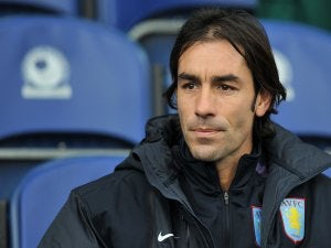 Pires rules out Arsenal return