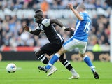 Cheick Tiote and David Jones
