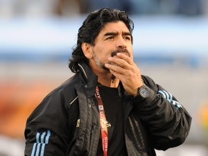 Maradona returns to Italy