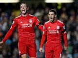 Maxi Rodriguez and Andy Carroll