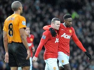 Rooney quietens Welbeck critics
