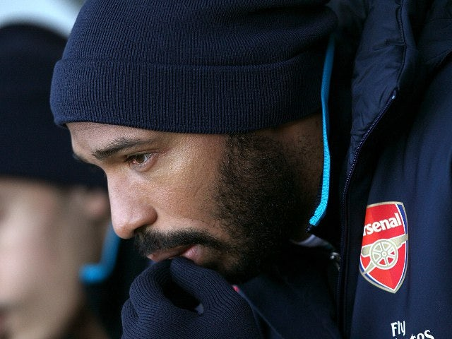 Henry clashes with Arsenal fan