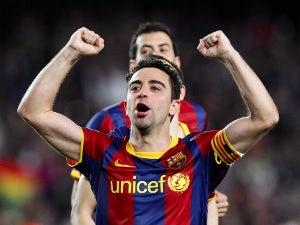 Xavi still a doubt for AC Milan tie