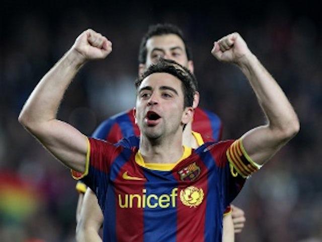 Xavi agrees new Barcelona deal