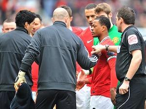 Evra happy after Suarez handshake
